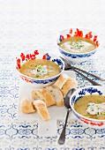 Potato and mustard soup with smoked salmon cream