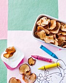 Homemade apple crisps as a snack for children