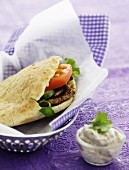Pita bread filled with lamb and tomato