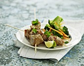 Pork skewers with sesame seeds and broccoli