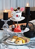 Cakes, biscuits, petit fours and cake pops for teatime in a restaurant
