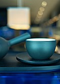 Blue tea bowl and a teapot in a restaurant