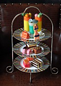 Mini cakes on a summery cake stand for teatime