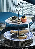 Sandwiches and caviar on a stand served with champagne