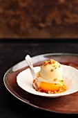 Poached peach halves with tonka bean ice cream