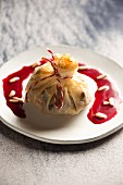 Rice and lamb in a pastry parcel with pomegranate sauce (Syria)