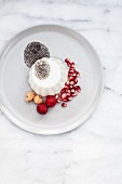 Panna cotta with chia seeds, pomegranate seeds and raspberries