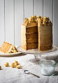 Salted caramel cake topped with popcorn, sliced