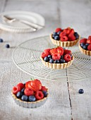 Berry tartlets on a cooling rack