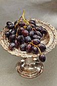 Red grapes on a silver dish