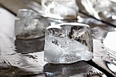 Ice cubes on a wooden table (close-up)