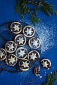 Mince pies with icing sugar (seen from above)