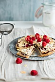 raspberry tart with almonds, sliced