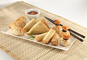 Various spring rolls with a chilli dip