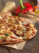 Gluten-free pizza with chicken and sausage