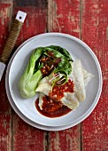 Fish with a spicy chilli sauce and bok choy (China)