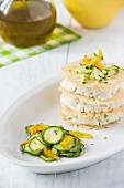 Parmesan mille feuille with fish mousse and a courgette salad