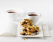 Muesli bites and cups of coffee