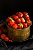 Strawberries in an antique pot