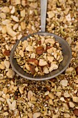 Dukkah spice mixture on a round spoon
