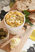 Artichoke paste with Parmesan, mayonnaise and sour cream served with olives and bread