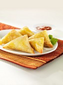 Oriental pastry parcels with a dip