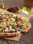 Gluten-free pizza with dried tomatoes and endives