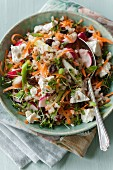 Rice salad with vegetables, feta cheese and raisins