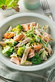 Pasta with salmon, broccolli and peas
