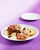 Biscuits with liver pâté, capers and pearl onions