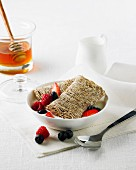 Shredded wheat with berries, milk and honey