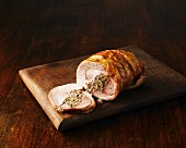 Stuffed turkey roulade on a chopping board