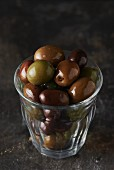 A glass of black and green olives