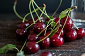 Sour cherries on a dark surface
