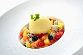 Fruit salad with vanilla ice cream