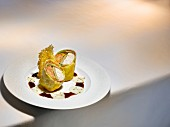 A dish by Eckart Witzigmann: veal sweetbread rolls with a champagne sauce