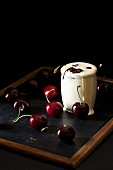 Cherries in a glass of cream
