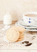 A stack of chai tea shortbread biscuits served with a cup of tea