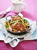 Breaded escalope on a bed of vegetables
