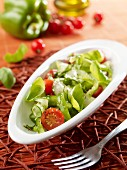 Pepper and cucumber salad with cherry tomatoes and basil
