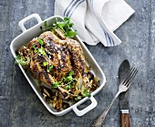 Roast chicken with pine nuts and water cress