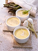 Three asparagus sources: sauce Bearnaise, aioli and honey mustard sauce