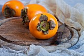 Persimmons on a wooden board