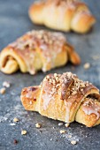 Almond croissant with white poppy seeds, icing and chopped nuts
