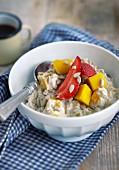 Muesli with mango, strawberries and sunflowerseeds