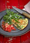Asparagus and potato frittata with tomato salad and rocket