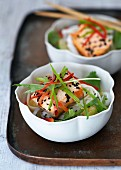 Noodles with salmon, vegetables and black sesame seeds