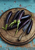 Aubergines on a wooden chopping board
