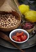 An arrangement of chickpeas, tomatoes and pomegranate seeds