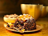 Christmas pudding on a golden plate